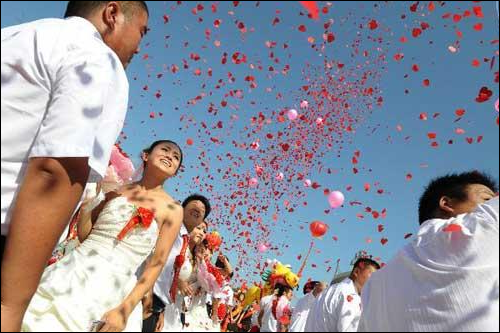 almost 80 couples getting married in a Qixi Festival mass-wedding event